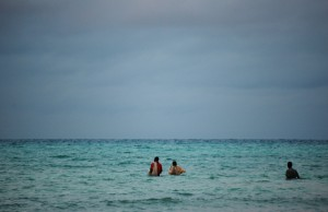 Fishermen walking out to sea at Zanzibar